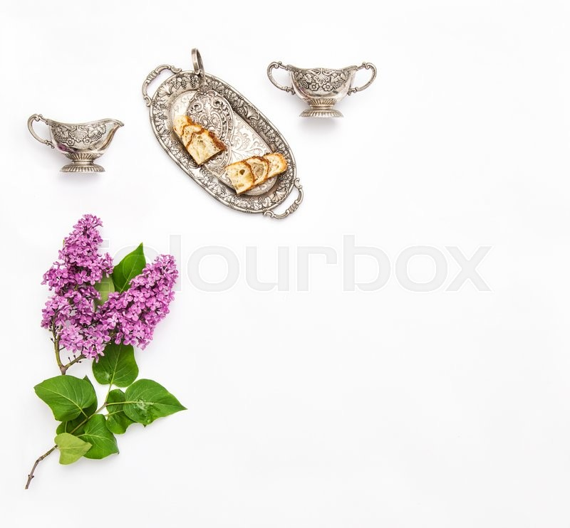 Stock image of 'Lilac flowers. Coffee tea pie silver dishes. Vintage objects. Flat lay background'