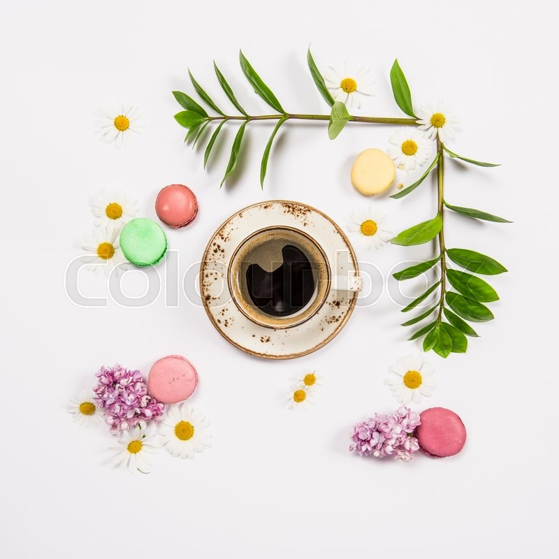 Stock image of 'Coffee, french cookies macaroons, spring flowers. Floral flat lay. Minimal concept'