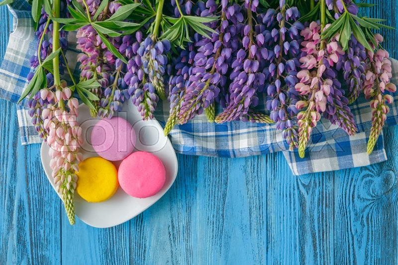 Stock image of 'Breakfast concept. summer flowers and macaroons on table'