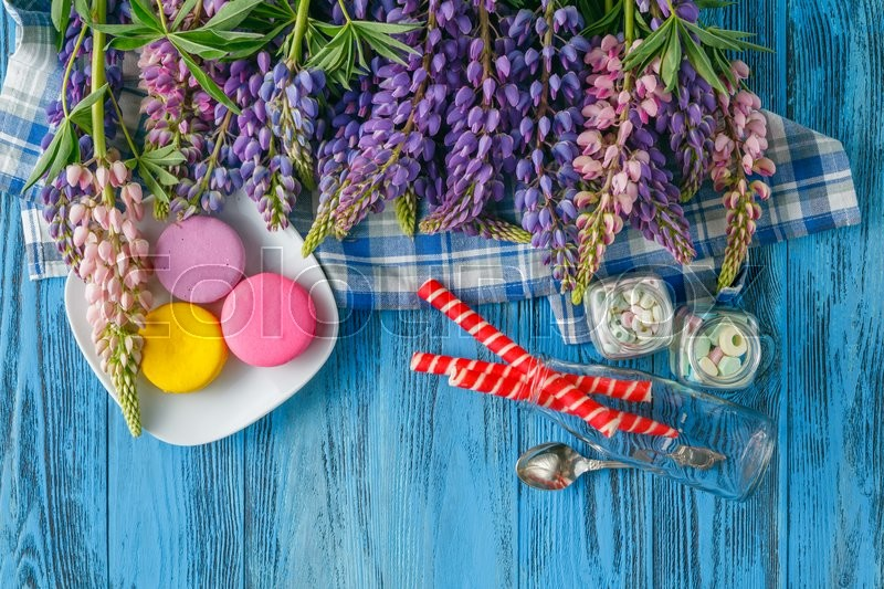 Stock image of 'Border from fresh lupine flowers on blue wooden planks.  Place for text.'