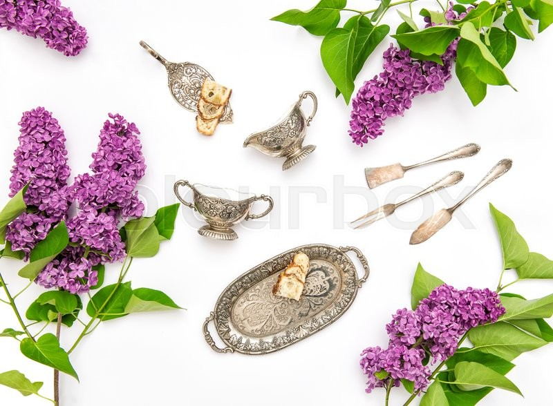 Stock image of 'Flat lay with lilac flowers. Coffee tea cake objects. Floral background'