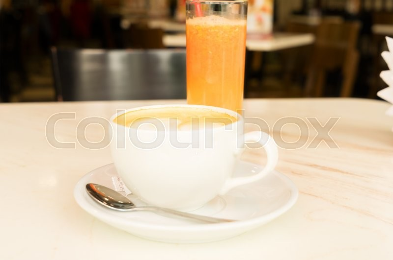 Stock image of 'Breakfast with coffee and fresh orange juice'