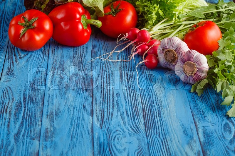 Stock image of 'Summer frame with fresh organic vegetables and fruits on wooden background'