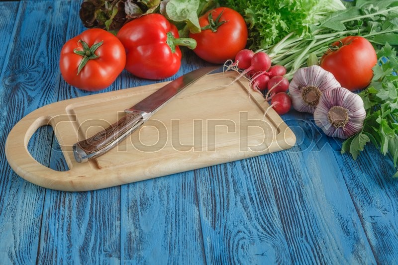 Stock image of 'Close up of various vegetables on wooden cutting board'
