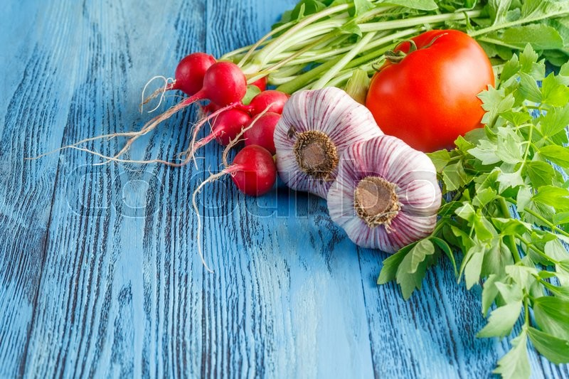 Stock image of 'Vegetables on wood. Bio Healthy food, herbs and spices. Organic vegetables on wood'