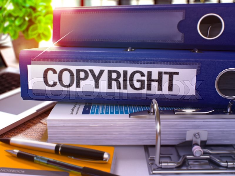 Stock image of 'Blue Office Folder with Inscription Copyright on Office Desktop with Office Supplies and Modern Laptop. Copyright Business Concept on Blurred Background. Copyright - Toned Image. 3D.'