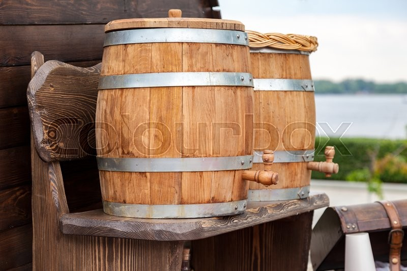 Stock image of 'Sale traditional Russian kvass from wooden barrels'