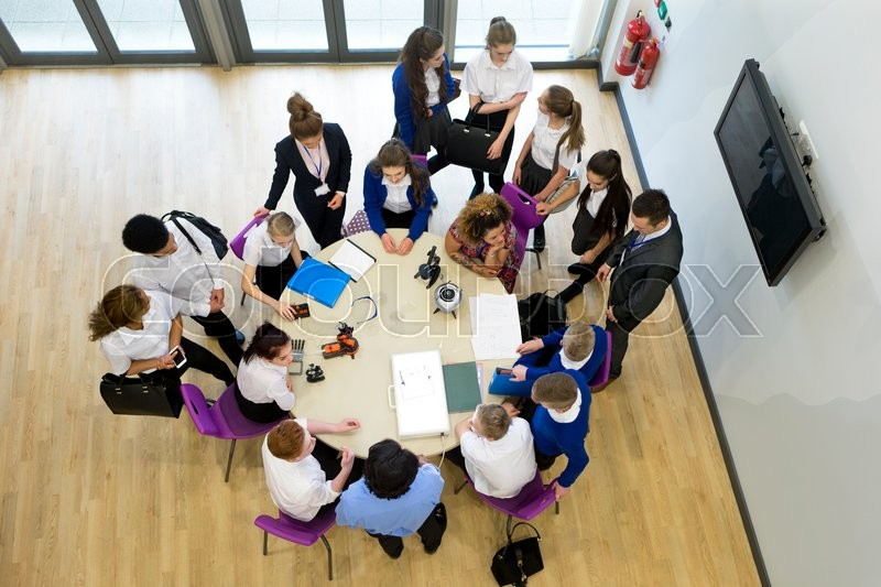 Stock image of 'Ariel view of a technology lesson in school. '