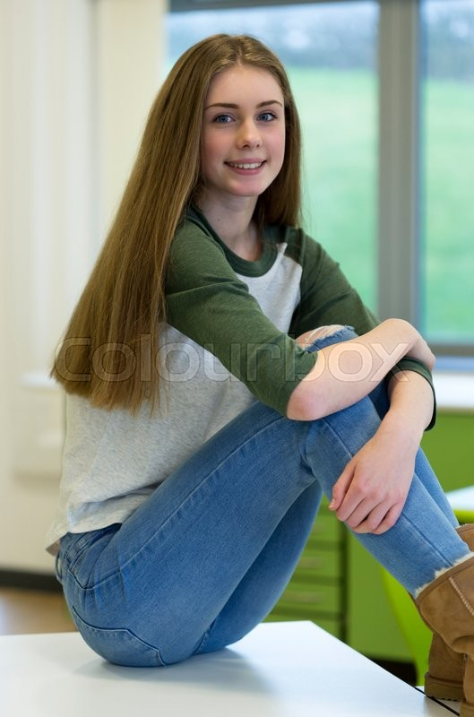 Stock image of 'Portrait of a teenage girl at school.'