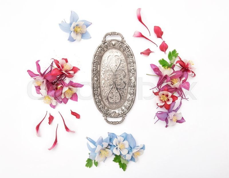 Stock image of 'Columbines flower frame and vintage silver plate. Flat lay background'