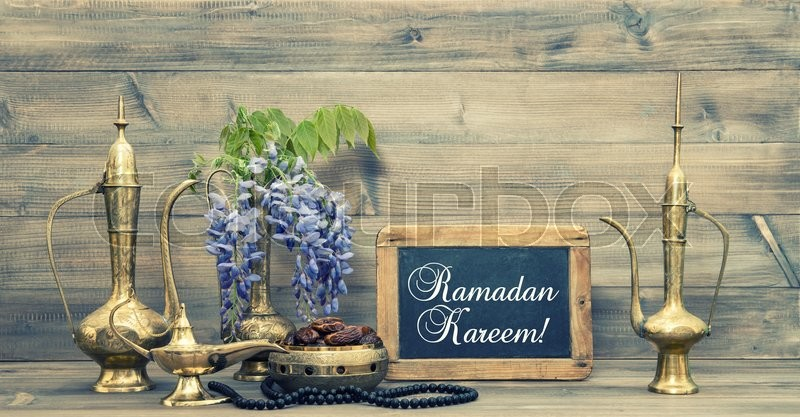 Stock image of 'Ramadan kareem. Golden oriental decorations and islamic rosary beads.  Vintage style toned picture'
