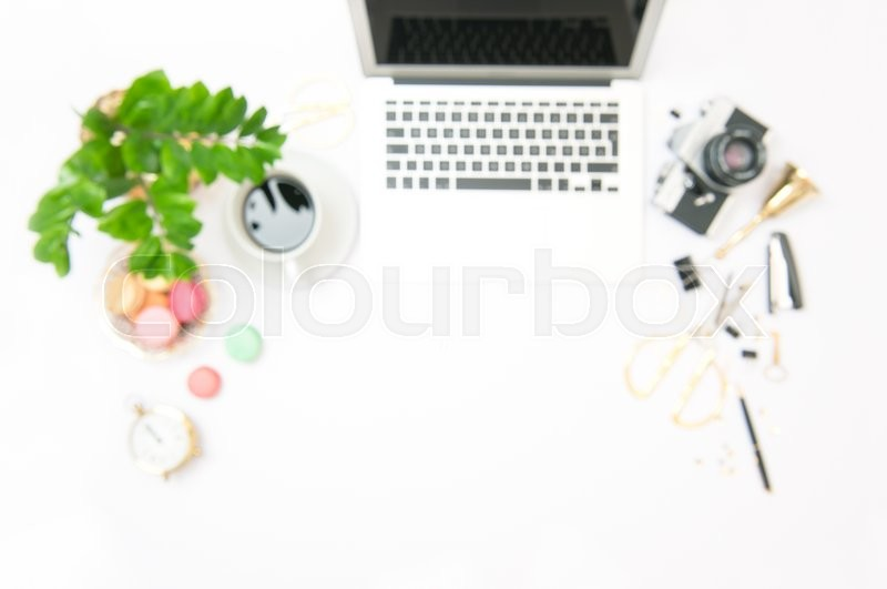 Stock image of 'Office workplace with laptop blurred background. Flat lay out of focus. Space for text'