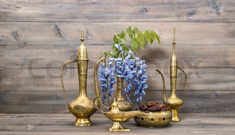 Stock image of 'Arabic jug, vase, lamp, tea pot. Fruits and flowers. Golden oriental decorations. Food and drink'