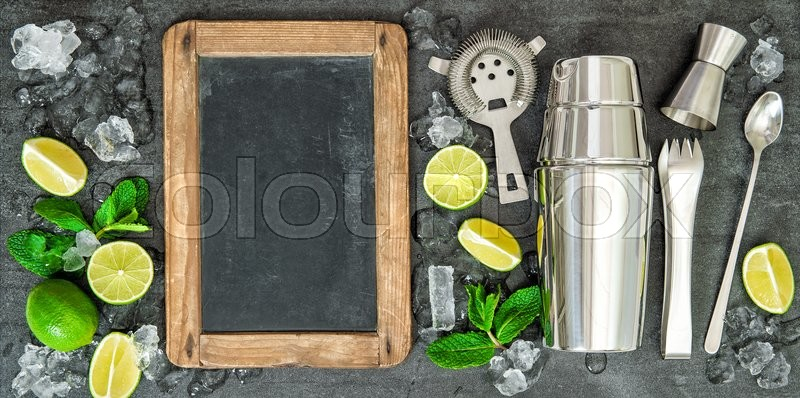 Stock image of 'Ingredients for cocktail drink. Lime and mint leaves. Chalkboard for Your recipe text'