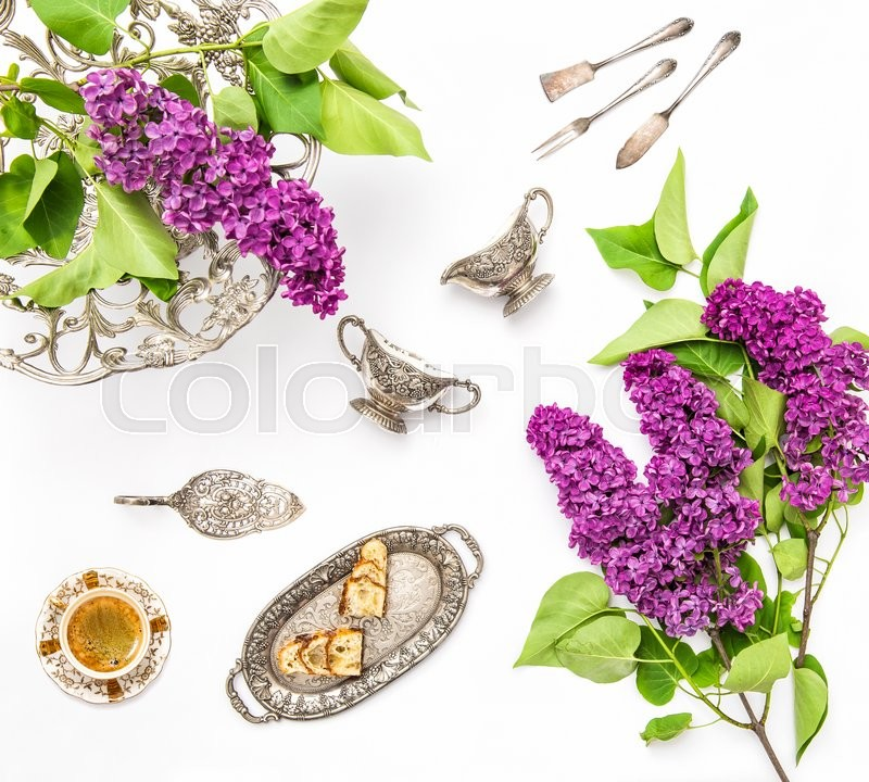 Stock image of 'Coffee with cake and antique silver dishes. Lilac flowers. Flat lay background'