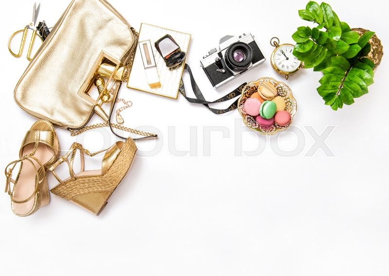 Stock image of 'Flat lay for social media fashion bloggers. Feminine accessories, bag, shoes, vintage no name photo camera on white background'