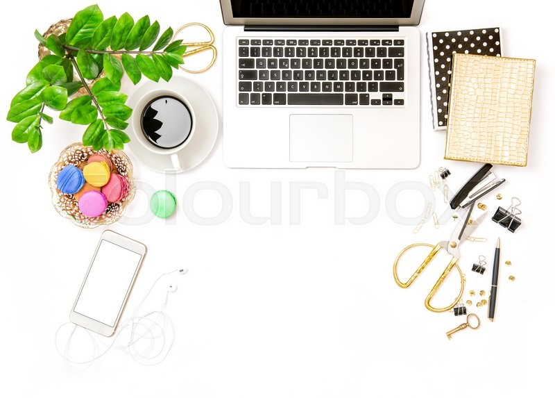 Stock image of 'Workplace for business lady. Office supplies and laptop. Creative working. Coffee and macaroon cookies. Flat lay'