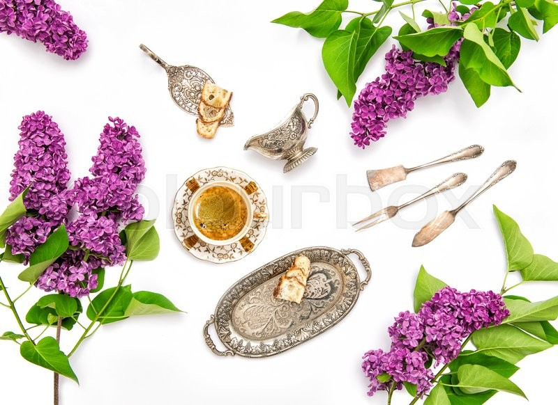 Stock image of 'Coffee with cake and vintage silver dishes. Lilac flowers. Flat lay background'