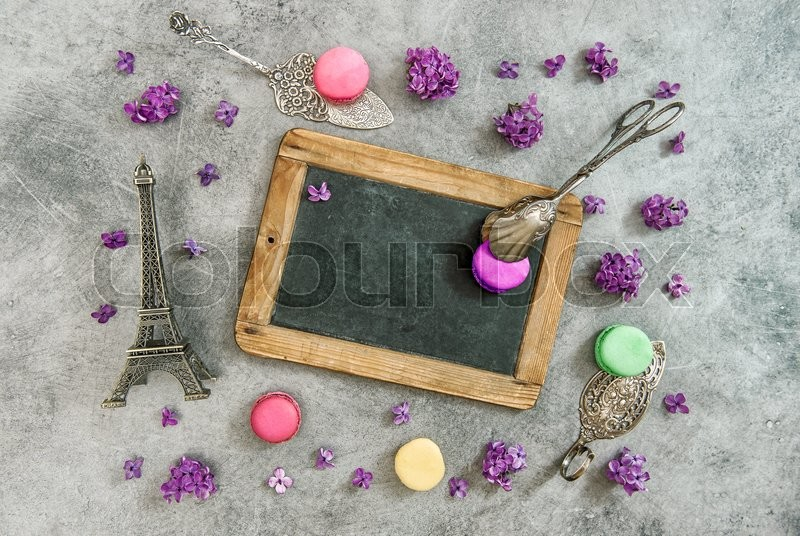 Stock image of 'Vintage chalkboard, macaroon cookies, Eiffel tower Paris souvenir. Antique decorations'
