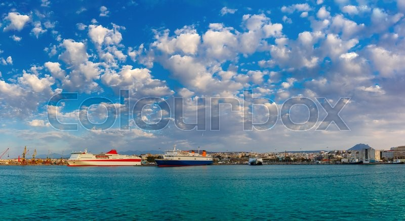 Stock image of 'Passenger ships in the sea port, loading, unloading cranes in cargo port of Heraklion, Crete, Greece. Panorama'