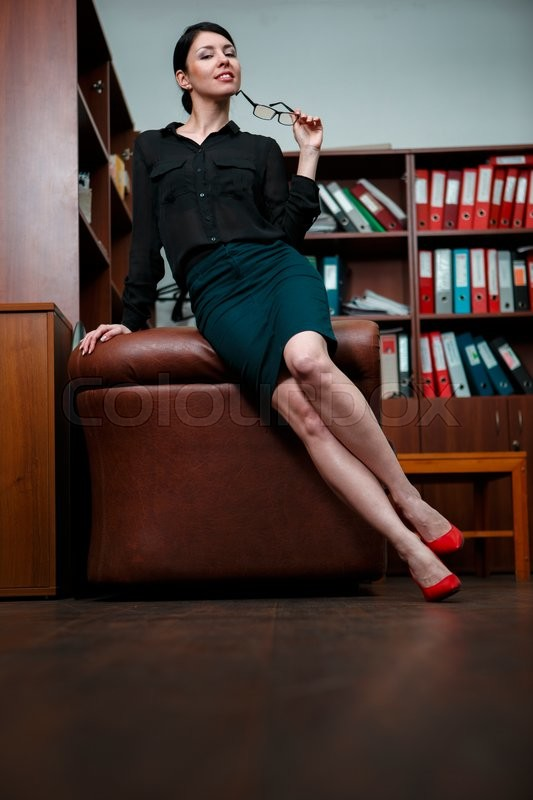 Stock image of 'Woman with flirting pose in office.'