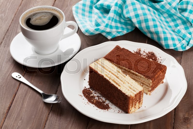 Stock image of 'Tiramisu dessert and coffee on wooden table'