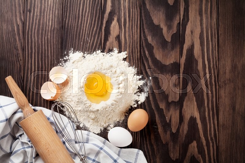 Stock image of 'Kitchen table with utensils and ingredients. Top view with copy space'