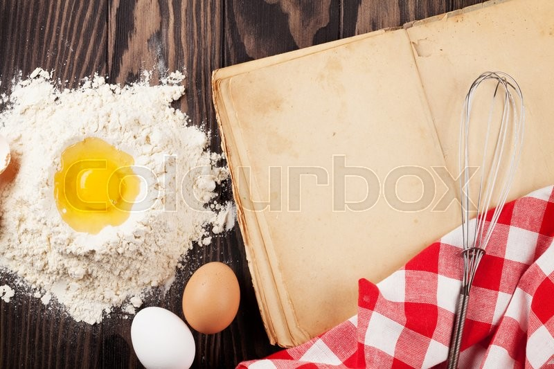 Stock image of 'Blank vintage recipe cooking book, utensils and ingredients on wooden table. Top view with copy space'