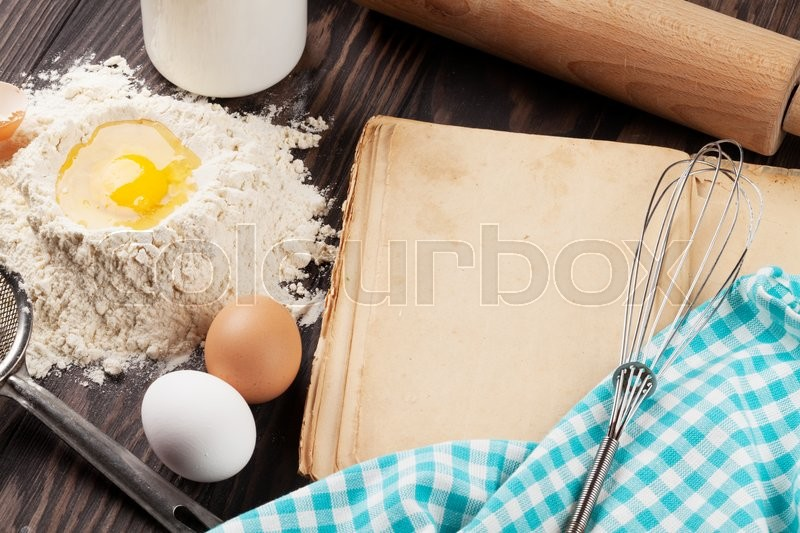 Stock image of 'Blank vintage recipe cooking book, utensils and ingredients on wooden table'