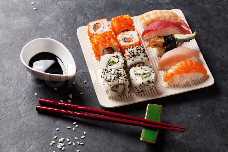 Stock image of 'Set of sushi and maki roll on stone table'