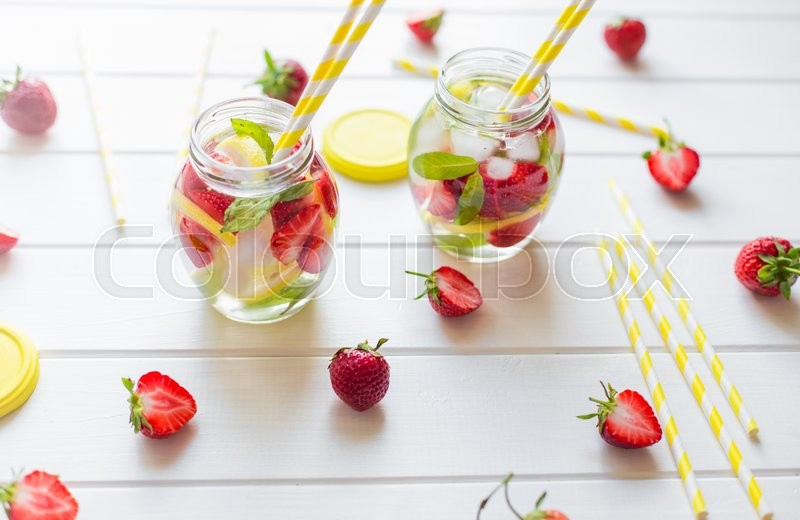 Stock image of 'Refreshing summer drink with Strawberry on the white wooden table'