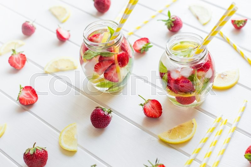 Stock image of 'Cold strawberries drinks with strawberry slices and mint at home'