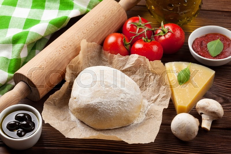 Stock image of 'Pizza cooking ingredients. Dough, vegetables and spices'