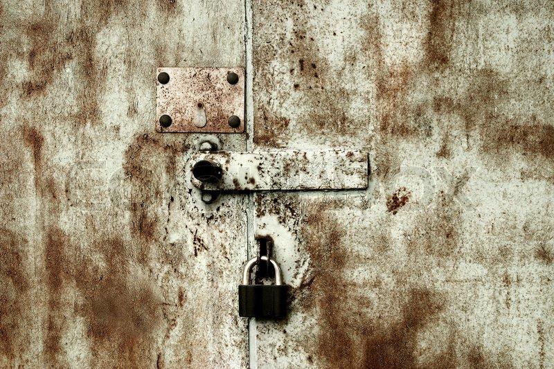Old Rusty Lock On The Garage Door Stock Photo Colourbox
