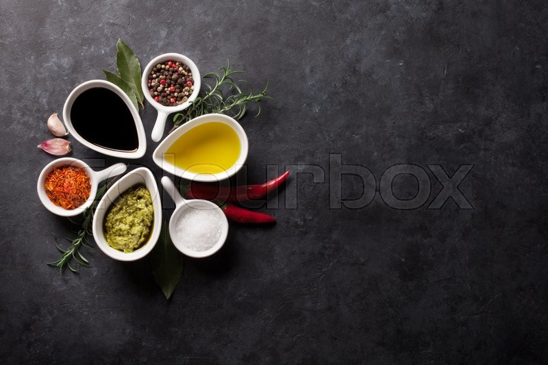 Stock image of 'Herbs, condiments and spices on stone background. Top view with copy space'