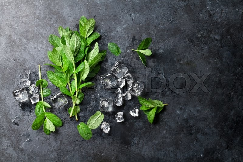 Stock image of 'Mint and ice on stone table. Top view with copy space'