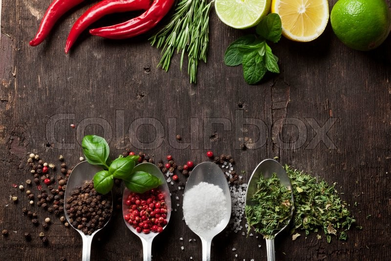 Stock image of 'Herbs and spices on wooden table. Top view with copy space'