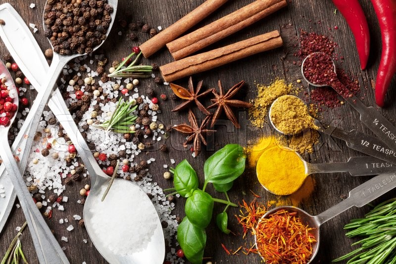 Stock image of 'Herbs and spices on wooden table. Top view'