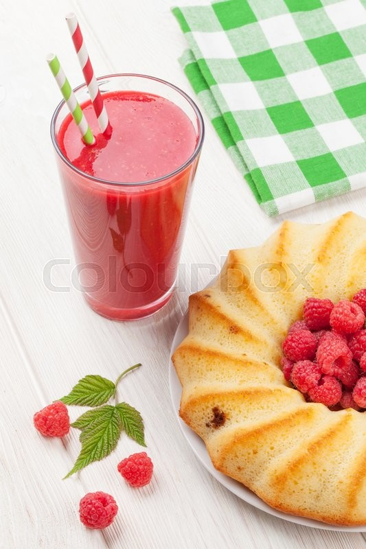 Stock image of 'Raspberry smoothie, cake and berries on wooden table'