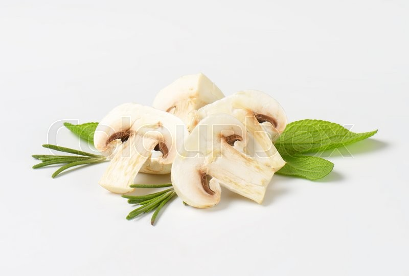 Stock image of 'Raw white mushrooms with herbs'