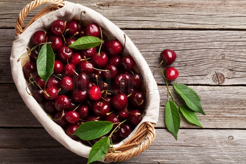 Stock image of 'Ripe cherry on wooden table. Top view with copy space'