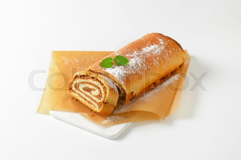 Stock image of 'Walnut Roll on baking paper'