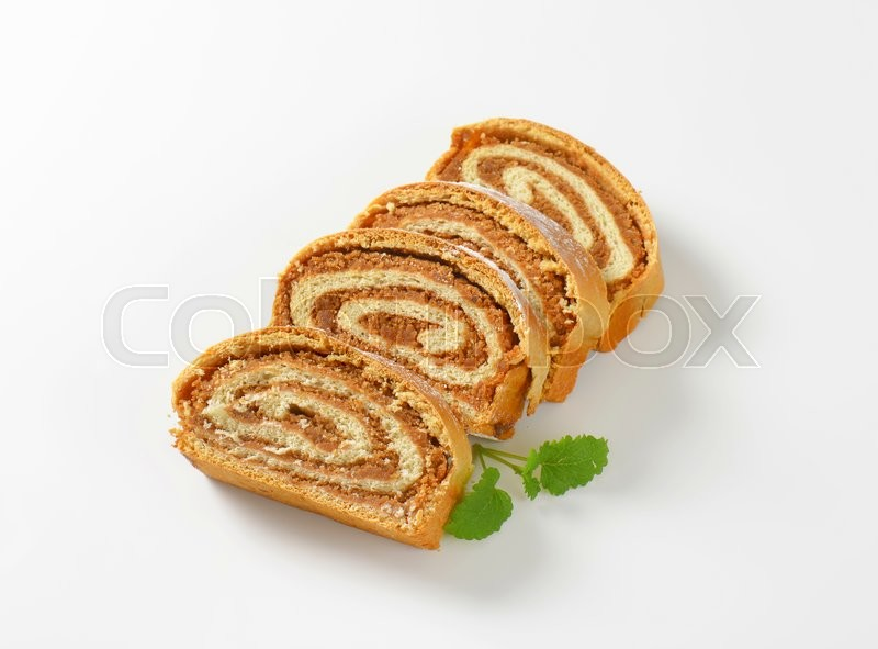 Stock image of 'Slices of sweet nut roll'