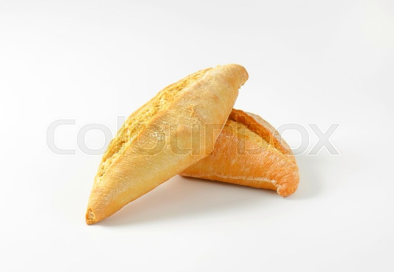 Stock image of 'Plain crusty bread rolls on white background'