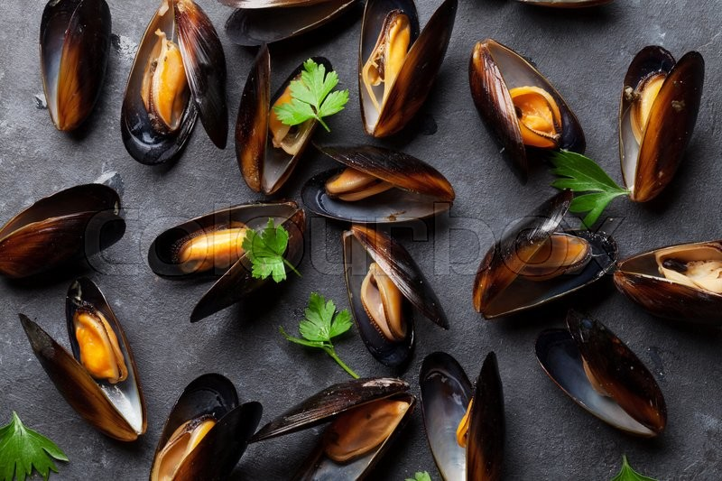 Stock image of 'Mussels with parsley on stone table. Top view'