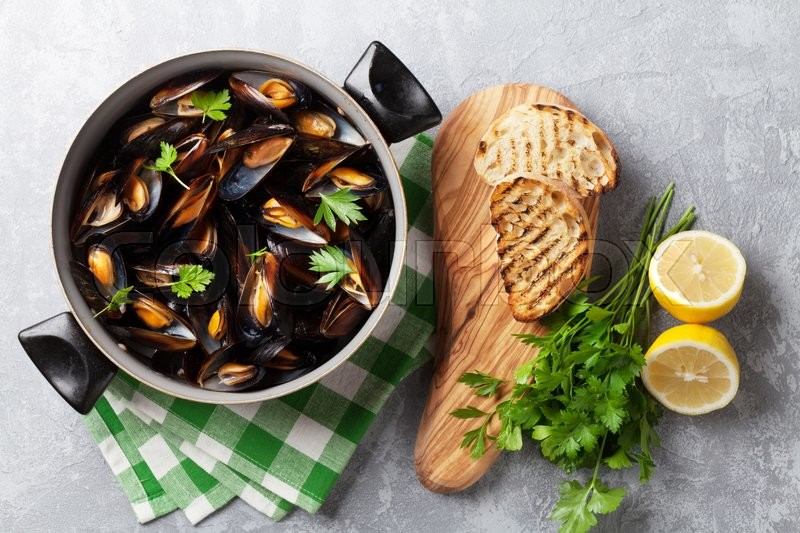 Stock image of 'Mussels and bread toasts on stone table. Top view'