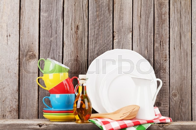 Stock image of 'Kitchen utensils on shelf against rustic wooden wall'