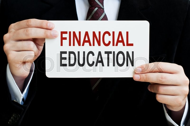 Stock image of 'Financial Education. Man holding a card with a message text written on it'