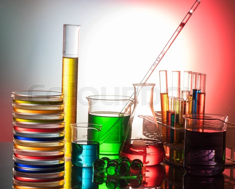 Stock image of 'Laboratory glassware still life with colorful reactives'