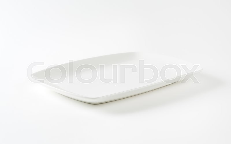 Stock image of 'Rectangle all-white porcelain plate with rounded corners'
